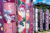 Detail of Kimono forest with poles decorated with kimono fabrics at Arashiyama Station, Kyoto, Japan