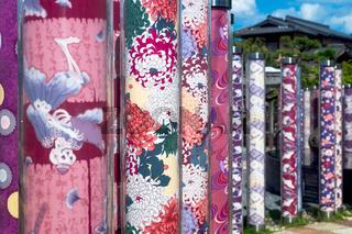 Detail of Kimono forest with poles decorated with kimono fabrics at Arashiyama Station in Kyoto, Japan