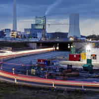 Motorway junction A 43 with A 42, power plant and construction site in the evening, Herne, Germany