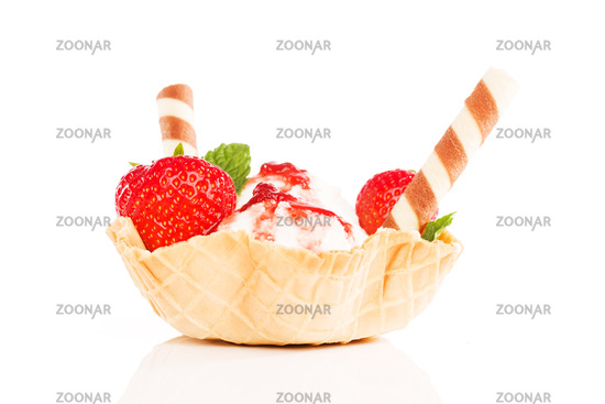 vanilla ice cream with strawberries in a waffle cu
