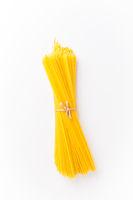 Spaghettini - thinner Spaghetti. Raw Spaghetti on white background.