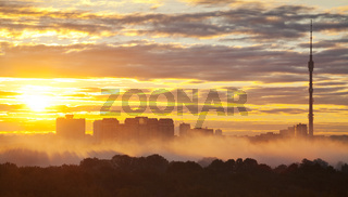 yellow sunrise in autumn city