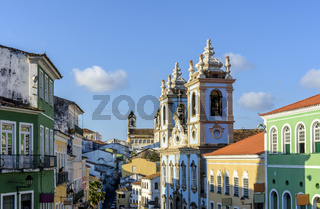 Old colorful houses facades and historic church towers in baroque and colonial style in Pelourinho, Salvador