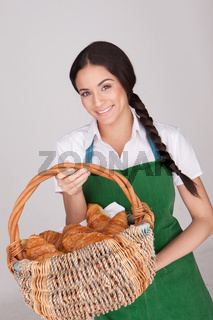 Beautiful woman with basket of croissants