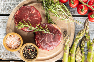 The raw beef meat steak on cutting board.
