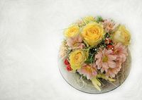 Floral arrangement of roses in autumn colors