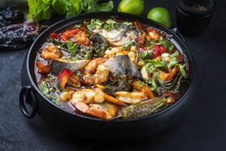 Modern style traditional Mexican seafood pozole soup with fish