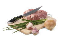 raw meat with onion and garlic isolated on white