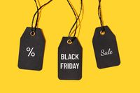 Group of price tags with Black friday sale text isolated on yellow background