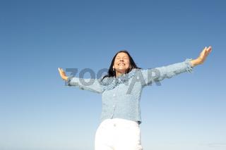 Joyful mature woman sky isolated