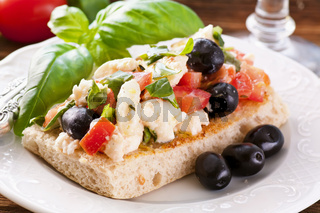 Bruschetta on focaccia with feta and olives