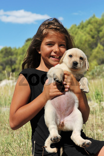 puppy labrador and smiling girl