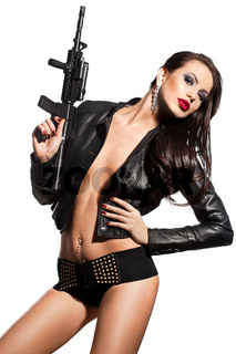 elegant fashionable woman with a gun in hands