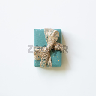 Green gift box isolated on white background. top view, copy space