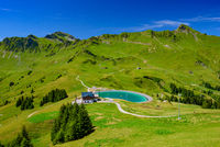 Landscape of mountains of Alps in summer with green meadow and a lake in Portes du Soleil, Switzerland, Europe