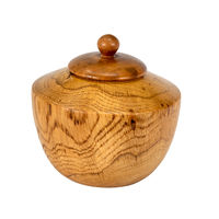 Side view of a turned oak wood jar with lid isolated on white
