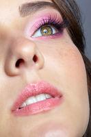 Closeup shot of human female face with pink makeup