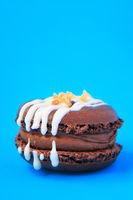 brown Cake macaron or macaroon on blue background