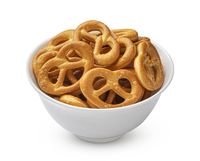 Salted pretzels in bowl isolated on white background