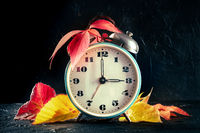 Daylight Saving Time concept, fall back in autumn. A vintage alarm clock