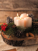 Third Advent candle burning, traditional Christmas decoration