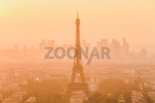 Aerial view of Paris with Eiffel tower and major business district of La Defence in background at sunset