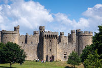 BODIAM, EAST SUSSEX, UK - JUNE 24 : View of tthe castle at Bodiam in East Sussex on June 24, 2009. Unidentified people