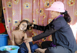 girl and mother in pnomh penh cambodia