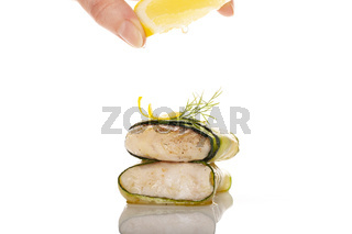 Luxurious seafood dinner. Perch fish fillet in zucchini slices.