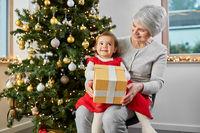 grandmother and baby girl with christmas gift