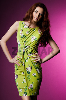 beautiful fashionable woman in green clothes
