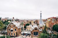 Barcelona, Spain - 15 December 2019: The central entrance to The Park Guell in Barcelona. Gingerbread houses.