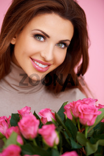 Gorgeous brunette with pink roses