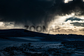 Dark storm clouds over snowy landscape Iceland abstract