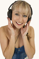 Blonde woman relaxing with music