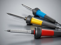 Soldering irons on gray surface. 3D illustration