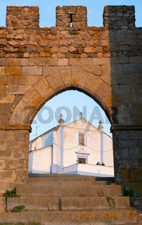 Gate entrance of old medieval castle of Arraiolos village with old church in Alentejo, Portugal