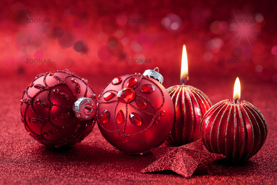 Christmas ornament with candles in red tone with glittering background