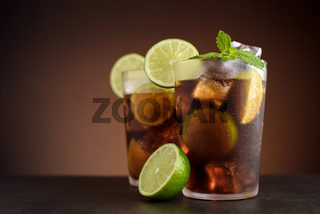 Cuba Libre cocktail. Alcoholic drink with cola, rum, lime and mint. Cuba Libre or long island iced tea cocktail.