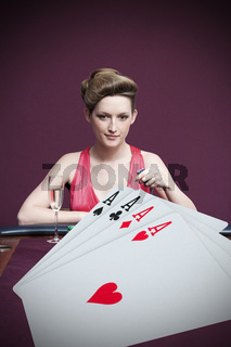 Attractive gambler betting on four aces