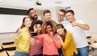 international students and teacher taking selfie
