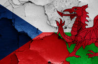 flags of Czech Republic and Wales painted on cracked wall