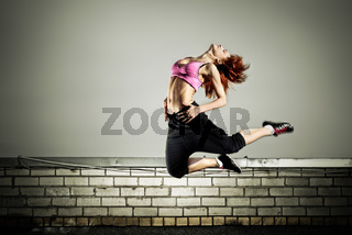 girl jumping on the roof