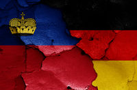 flags of Liechtenstein and Germany painted on cracked wall
