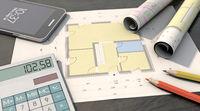 Floor plan with media plan, pens, calculator and smartphone