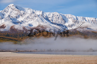 Altai lake Dzhangyskol on mountain plateau Eshtykel. Morning fog over water. Altai, Siberia, Russia