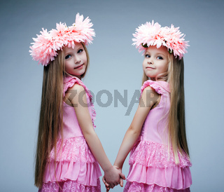 Pretty little girls in pink dresses