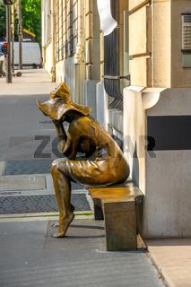 Street Sculpture of a Girl in Sunny Summer Paris