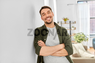 happy smiling man with crossed arms at home