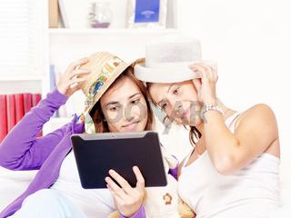 happy teenage girls having fun using touchpad